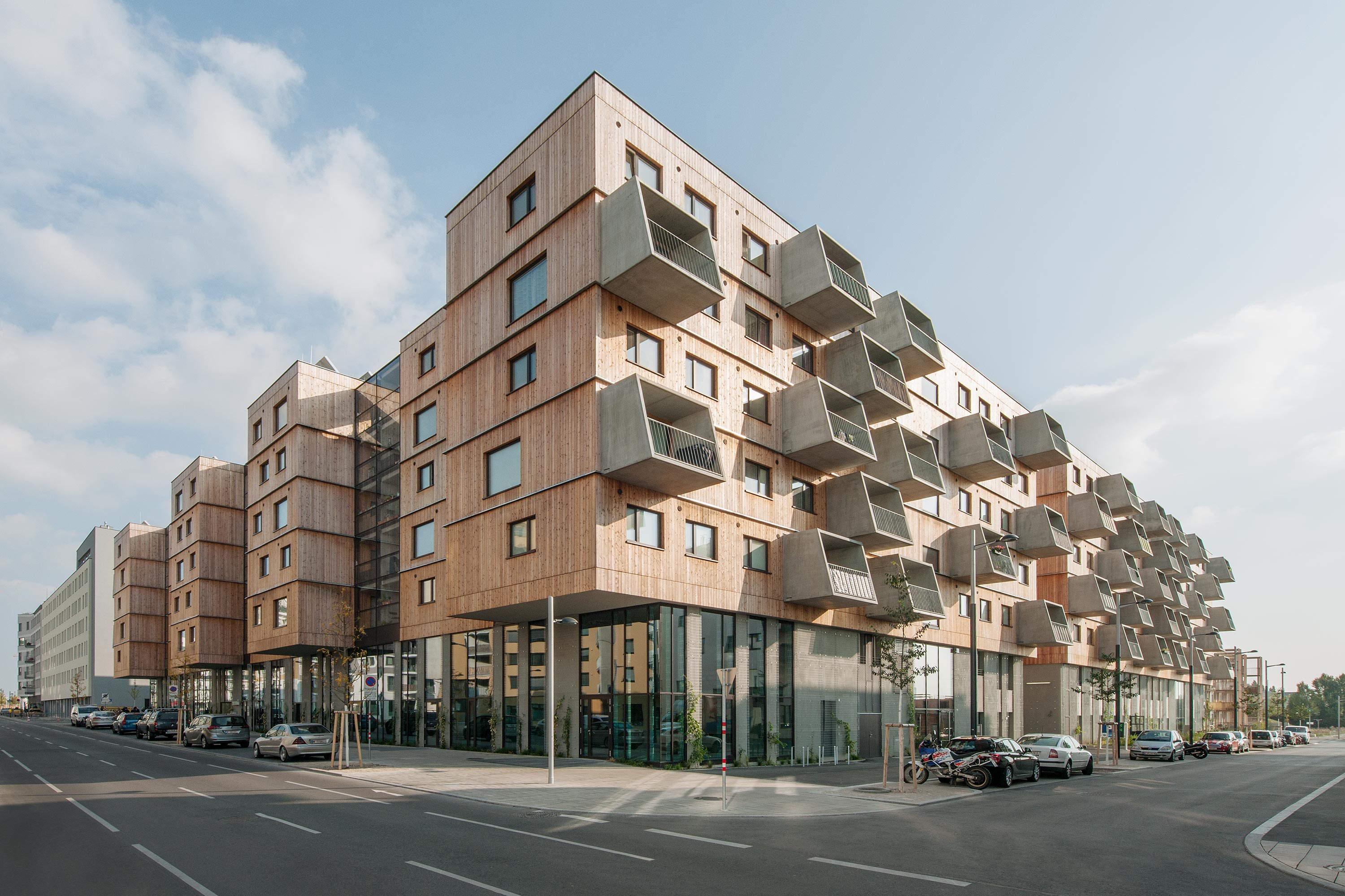 Wood Housing Seestadt Aspern, street view. Photo: Hertha Hurnaus | Berger+Parkkinen Architekten | querkraft